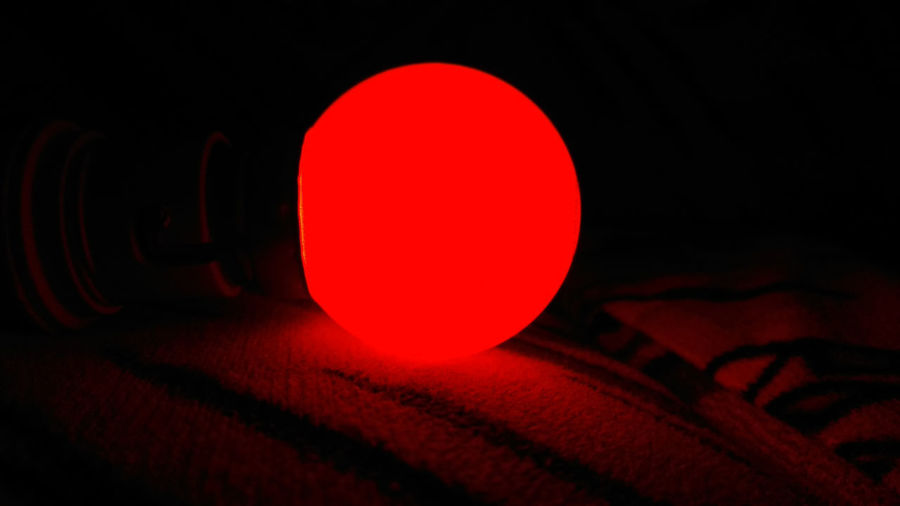 Close-up of ball on table against black background