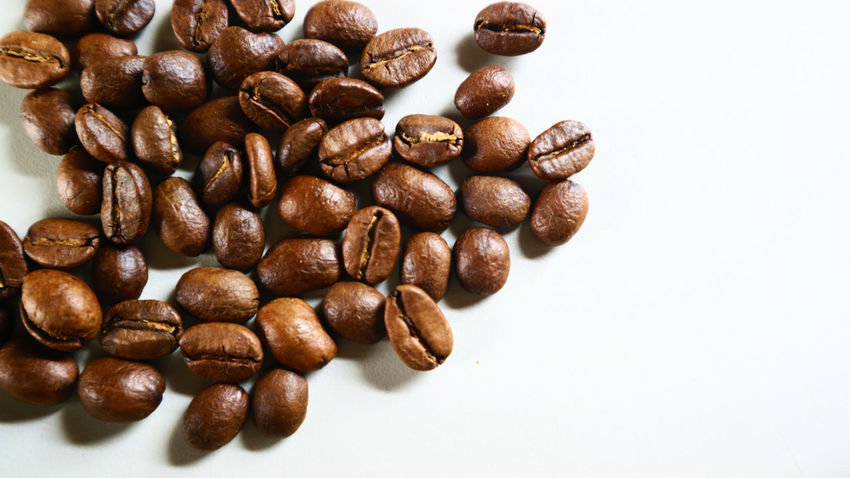 The Coffee Bean Brown Close-up Coffee - Drink Coffee Bean Coffee Cup Food Food And Drink Freshness Indoors  Mocha No People Raw Coffee Bean Roasted Coffee Bean Scented Studio Shot White Background