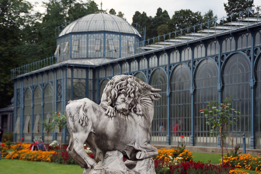 Before the historic greenhouse at Wilhelma Stuttgart is a dynamic sculpture, depicting a lione who just rips an antelope. Botanical Gardens Dramatic Glashouse Lion Sculpture Statue Stuttgart Stuttgart City Stuttgart,Germany Wilhelma Wilhelma Stuttgart Wilhelma Zoo