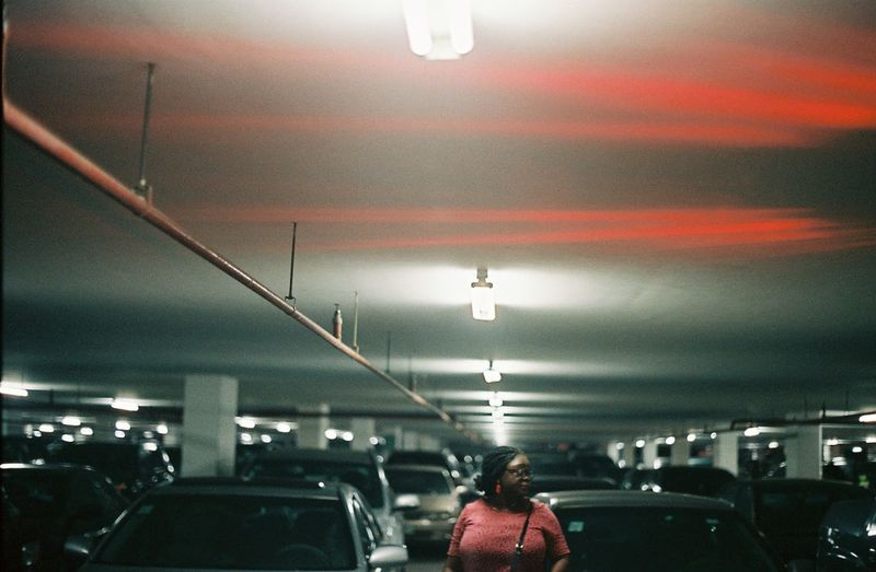 Rear view of woman in parking lot