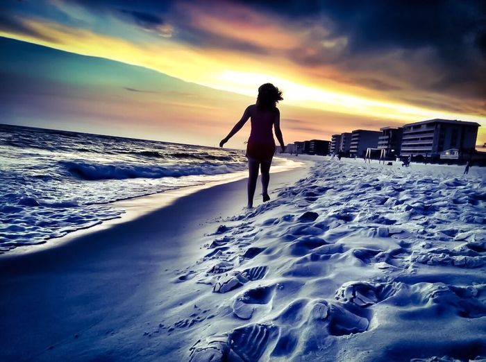 People Of The Oceans during our annual vacation to Okaloosa Island, I was lucky enough to catch this shot. This is my daughter walking into the sunset Oceanside Daughter