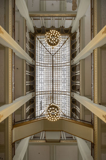 Low angle view of illuminated chandelier hanging from ceiling