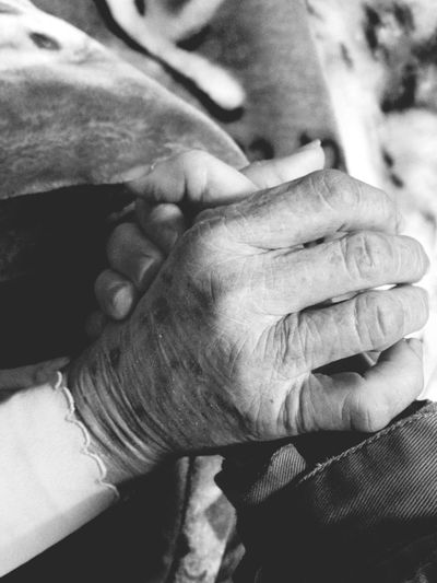 Close-Up Of Senior People Holding Hands