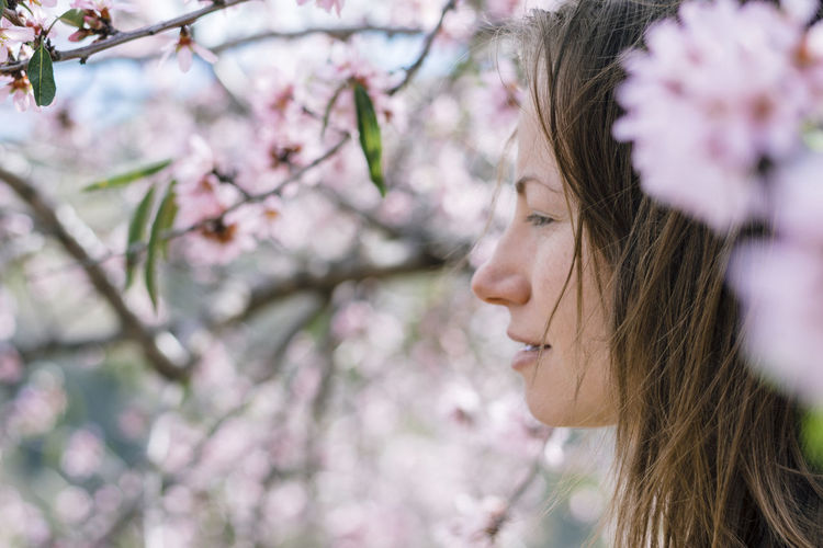 Close-Up Of Woman Amidst Flowers