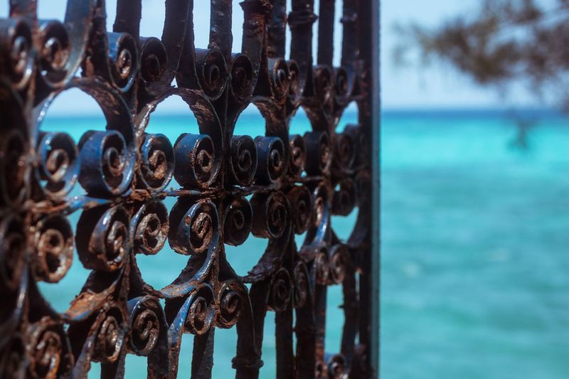 Heavens gate Travel Beautifuldestinations Beautiful Zanzibar Tanzania Water Focus On Foreground Metal No People Day Sea Close-up Safety Protection Outdoors Railing Rusty Tranquility Nature Blue Sky Barrier
