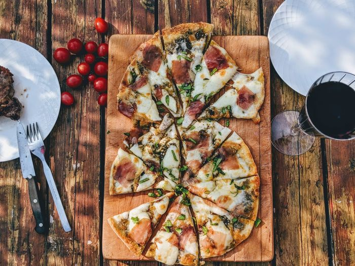 High angle view of pizza on wooden table