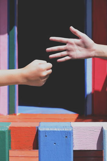 Close up 2girl's hands playing rock paper scissors on colorful children wooden house in playground at primary school in vertical frame Togetherness Win Lose Door Rock Paper Scissors Wooden House Playground Female Girl Playing Vertical Frame Children Multicolored Fence Sunlight Outdoor Detail Lifestyle EyeEm Selects Human Hand Close-up Finger Palm Human Finger Door Sign Language Hand Body Part Personal Perspective Outdoor Play Equipment