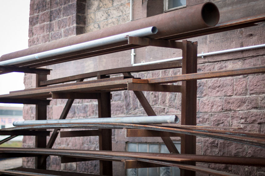 Pipe storage in an industrial area in Karlsruhe 2017 Industrial Photography Industry Pipeline Rust Storage Space Architecture Brick Building Brown Color Building Exterior Built Structure Close-up Day Daytime Photography Insdustrial No People Outdoors Pipe - Tube Pipes Red Color Rusty Shelf Storage Compartment