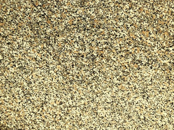 Full frame shot of pebbles on sand