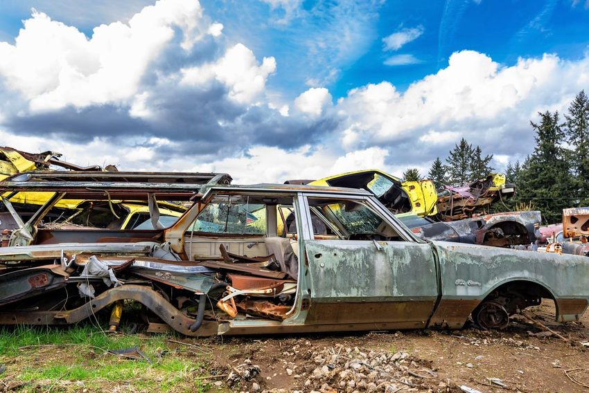 Abandoned Bad Condition Car Cloud - Sky Damaged Day Decline Demolished Deterioration Junkyard Land Vehicle Mode Of Transportation Motor Vehicle Nature No People Obsolete Old Outdoors Plant Ruined Run-down Rusty Sky Transportation Tree