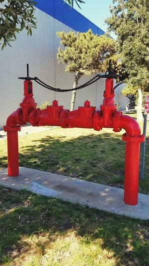 Red Fire Hydrant Pipes Valves Cherryred Asthetics Symetrical Asthetically Pleasing Manufacturing, Production; Construction Outdoors Clean