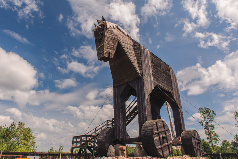Low angle view of the trojan horse against cloudy sky