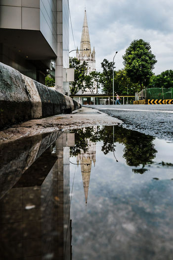 Reflection of building and trees on water