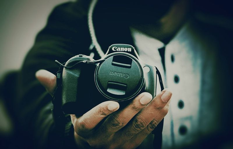 Camera in hand Human Hand Men Close-up Camera - Photographic Equipment Digital Camera Photographer Camera SLR Camera Photography Themes Lens - Eye Camera Flash Photographing Digital Single-lens Reflex Camera Personal Perspective