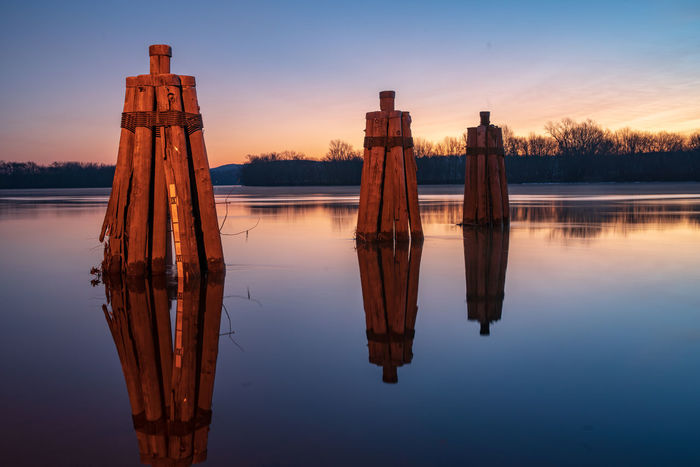 The Dock at Ferry Landing in Rocky Hill Connecticut at dawn in winter Sky Water Reflection Sunset Lake Waterfront Tranquility Nature Wood - Material No People Post Beauty In Nature Dusk Tranquil Scene Scenics - Nature Wooden Post Nautical Vessel Non-urban Scene Symmetry