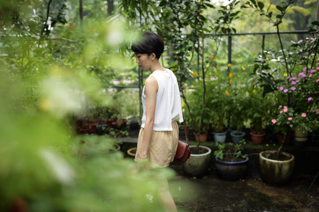 Asian Girl Casual Clothing Day Focus On Foreground Garden Grass Growth Leisure Activity Lifestyles Nature Outdoors Park Plant Plant Porn Relaxation Selective Focus Sitting Tree