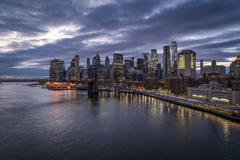 Longexposure Sunset Skyline Holiday Vacation Time New York Vacations Travel Travelphotography Vacation Building Exterior Architecture Built Structure Water City Building Office Building Exterior Sky No People Urban Skyline Cityscape Cloud - Sky