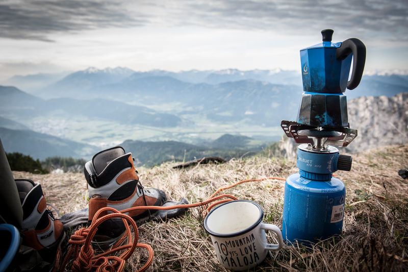 There's always time for a cup of coffee Outdoor Camping Mountain Land Nature Field Day Beauty In Nature Scenics - Nature Tranquility Mountain Range Landscape Tranquil Scene Environment Non-urban Scene Sky No People Idyllic Outdoors Plant Sunlight Cloud - Sky Camping Stove Coffee Stove