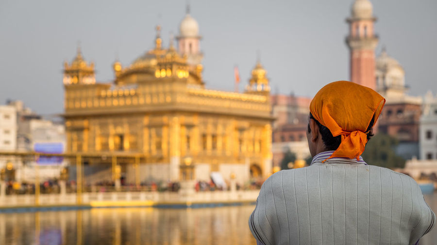 Rear view of man at golden temple