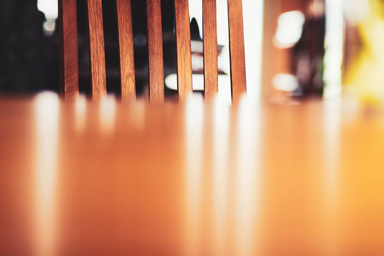 Close-up of metallic chairs at table