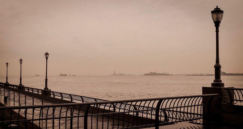 New York tranquility New York City New York Street Light Railing Sea Water Sky Outdoors No People