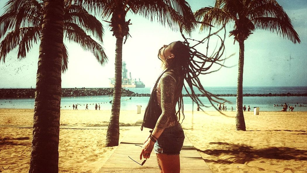 Beach Sand Palm Tree Sea Only Women People Water Vacations Dreadlocks Dreadhead Dreadgirl Motion Tenerife Island Outdoors Sunshine Goodday Tattoo Tattooed Tattoos Tattooedgirls