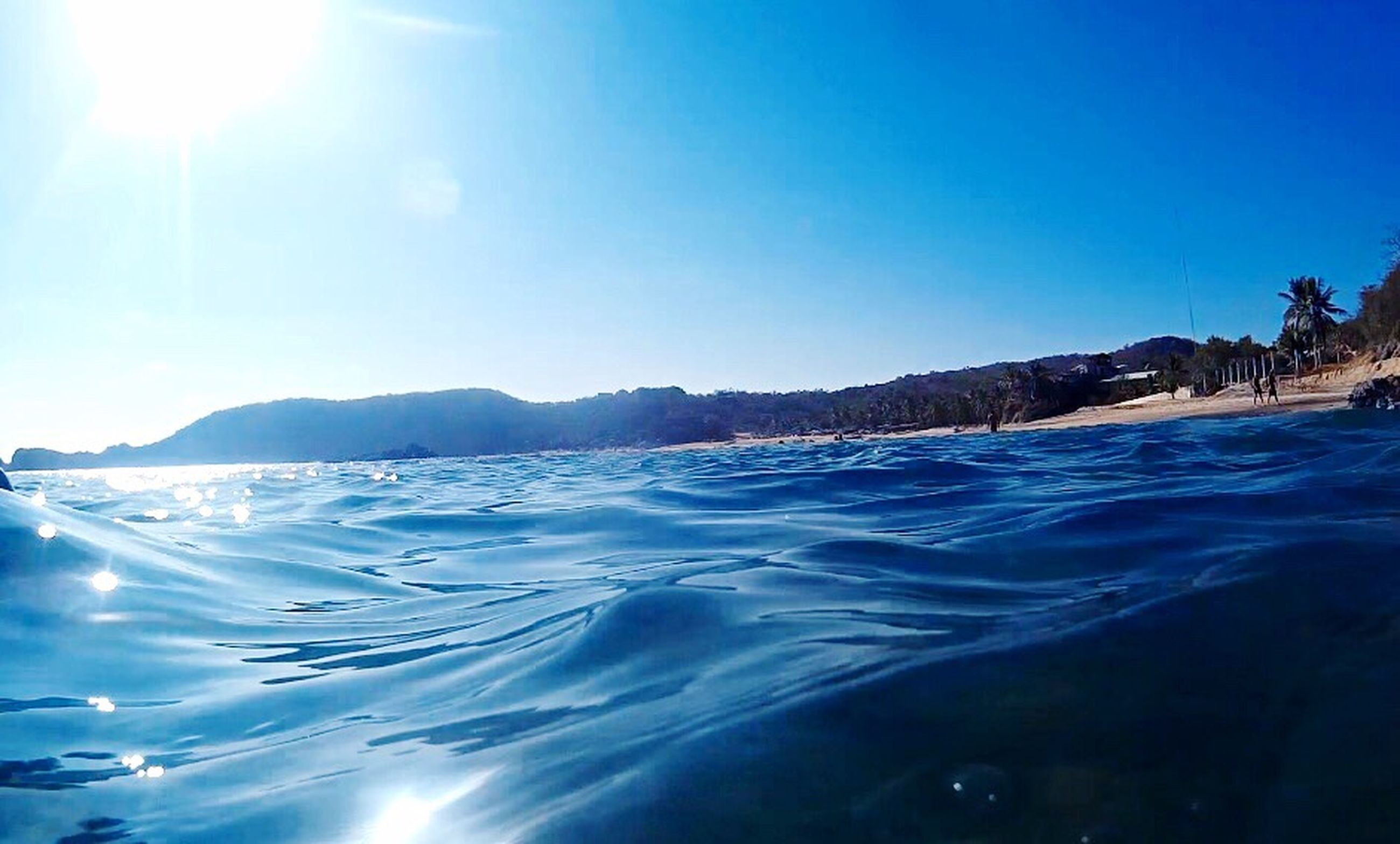 blue, beauty in nature, scenics, nature, sea, landscape, outdoors, sky, mountain, cold temperature, clear sky, tranquil scene, water, ice, no people, day, refraction