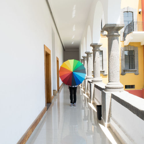 Alone Architectural Column Architecture Built Structure Corridor Day Full Length Indoors  Lifestyles One Person Pasión  Person Perspectiva Point Of View Punto De Vista Real People Sombrilla Umbrella Walking