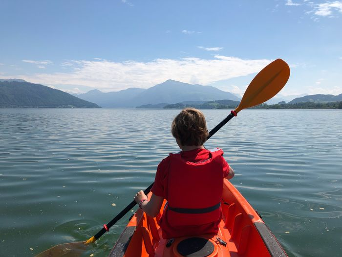 Kayaking on Lake Zug Positive Bright Orange Blue Sunny Rigi Boy Lake Water Zugersee Oar Nature Sky Kayak Nautical Vessel Adventure Vacations Holding Mountain Range Beauty In Nature Transportation Outdoors Holiday Paddling