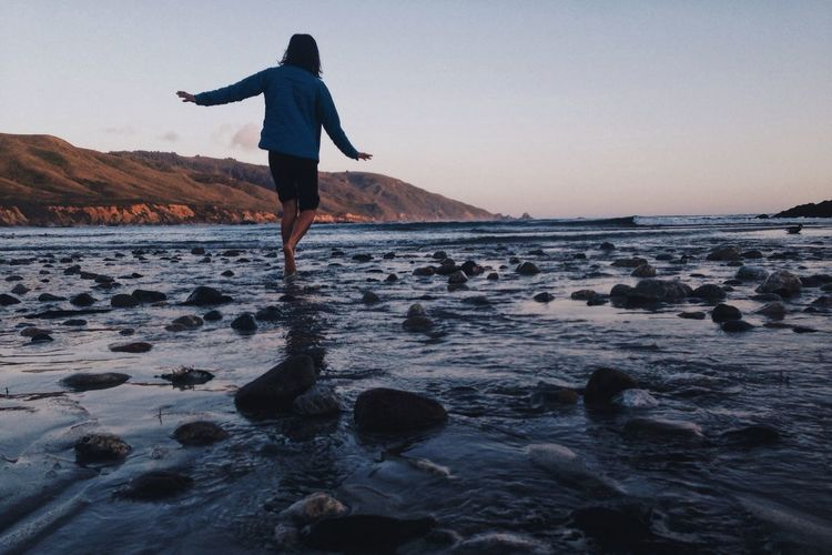 California Coast Adult Beach Beauty In Nature Camping Day Frolicking Full Length Leisure Activity Nature One Person One Woman Only Outdoors People Real People Sea Skill  Sky Water