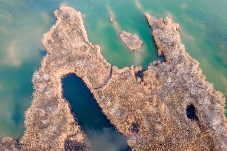High angle view of rusty metal on sea