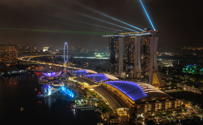 Marina Bay Sands light show Luxury Hotel Highway Singapore Singapore View Singapore City Marina Bay Sands Marina Bay Evening Waterfront High Angle View City Illuminated Cityscape Nightlife Popular Music Concert Business Finance And Industry Sky Light Painting Long Exposure Ferris Wheel Skyscraper Capture Tomorrow