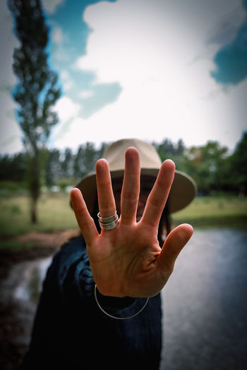Close-up of person hand outdoors