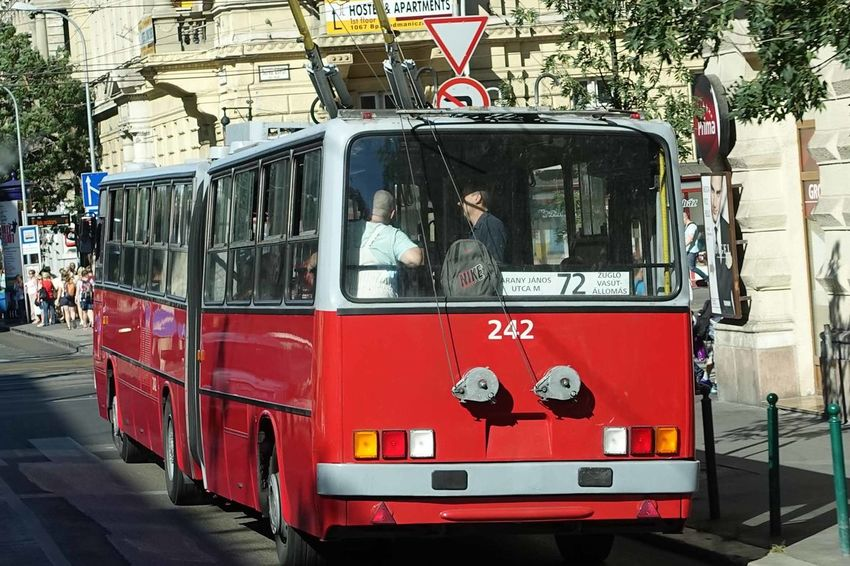 Budapest, Hungary - A city trolley bus picking up passengers Budapest, Hungary, Day Land Vehicle Men Outdoors People Public Transportation Real People Red Bus Street Scenes Transportation Trolley Bus Women