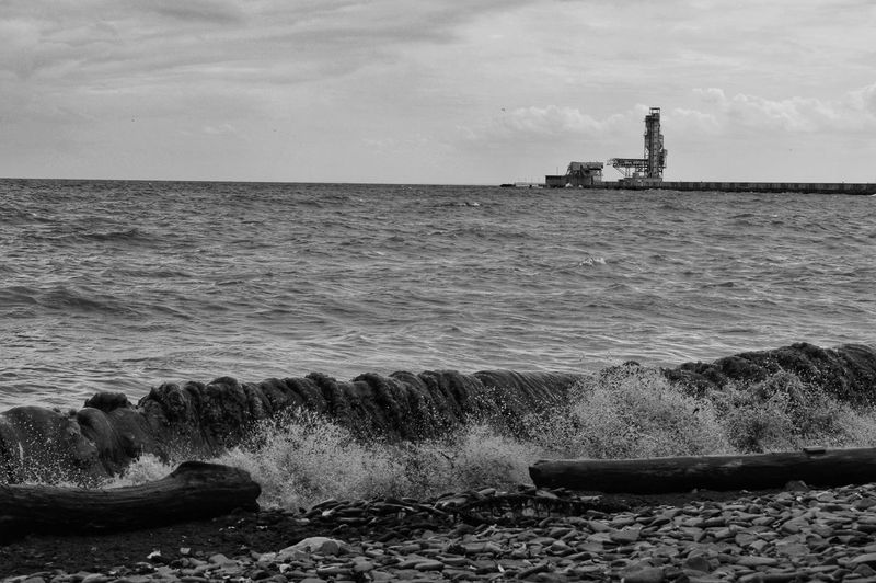 Angry waters. Nature Outdoors Nikon D3200 Nikon Photography Black And White Photography Black And White Nature Portraits Offshore Platform Water Oil Industry Wave Silhouette Beach Sky