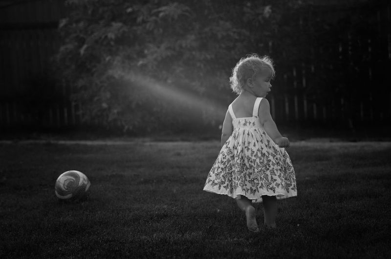 Young Girl Playing In Grass