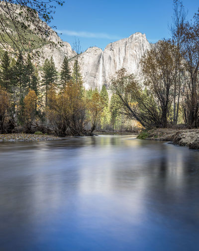 Scenic view of merced river against mountains