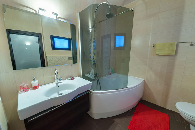 Bathroom Domestic Bathroom Domestic Room Indoors  Home Sink Mirror Household Equipment Bathtub No People Hygiene Tile Flooring Home Interior Faucet Luxury Toilet Wealth Modern Illuminated Tiled Floor