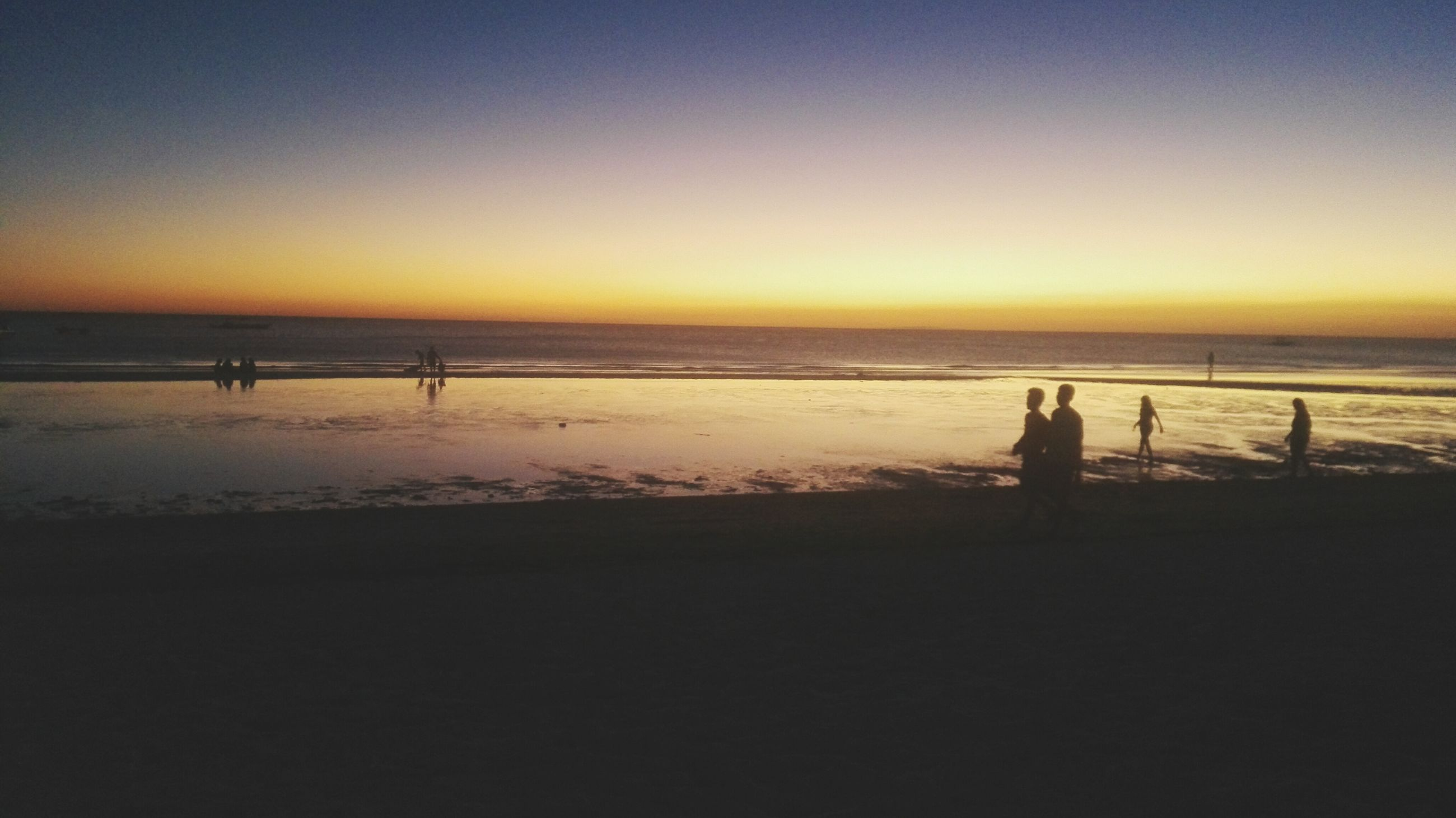 beach, sea, sunset, water, horizon over water, silhouette, shore, leisure activity, lifestyles, sand, scenics, beauty in nature, tranquil scene, copy space, men, vacations, tranquility, clear sky, orange color