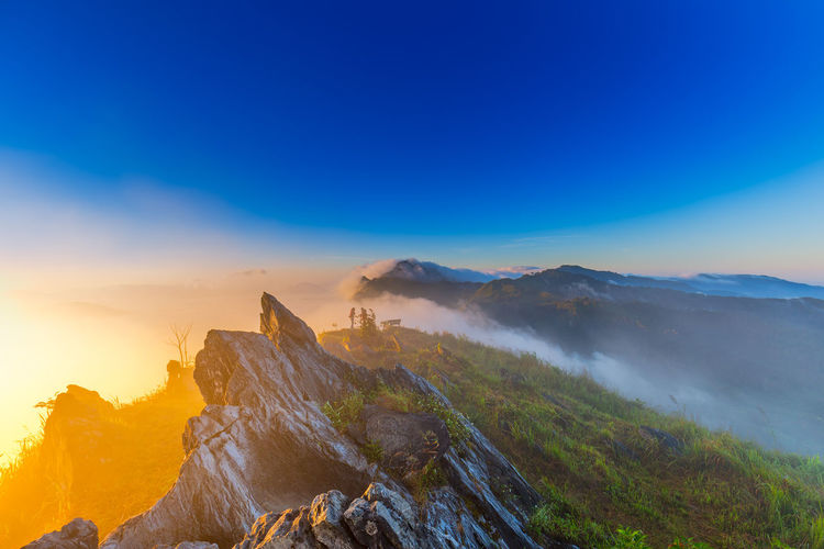 Beautiful sunrise at the top Doi Pha Tang in Chiang rai , Thailand Beautiful Blackground Camping Family Fresh Air & Nature Morning Yoka Amazing Beauty In Nature Borderline Cliffside Clouds And Sky Colorful Fog Landscape Meadows And Fields Mist Mountain Park Sun Sunrise Sunset Tent Wallpaper Women