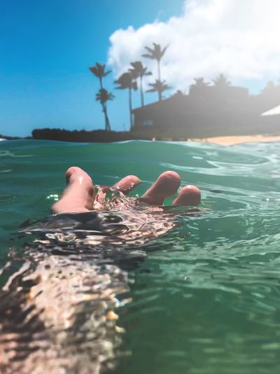 Contact Blue Ocean Travel Destinations World Travel Hawaii Life Hawaii Water One Person Real People Leisure Activity Lifestyles Nature Sea Cloud - Sky Sky Body Part Day Human Body Part Vacations Holiday Trip Beauty In Nature Swimming Sunlight Outdoors Finger
