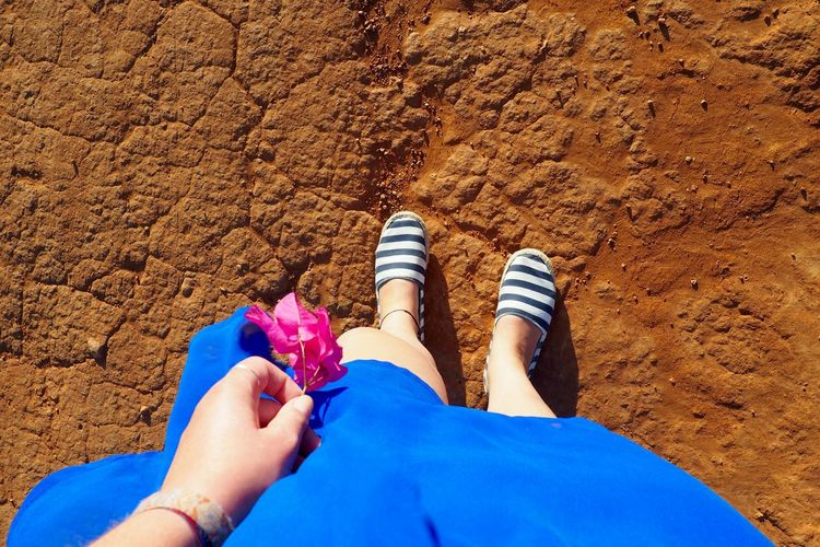 Adult Adults Only Beach Blue Bougainvillea Close-up Day Dress High Angle View Human Body Part Human Leg Lifestyles Low Section Nail Polish Outdoors People Portugal Real People Red Ground Standing Stripes Pattern Summer Togetherness Travel Women
