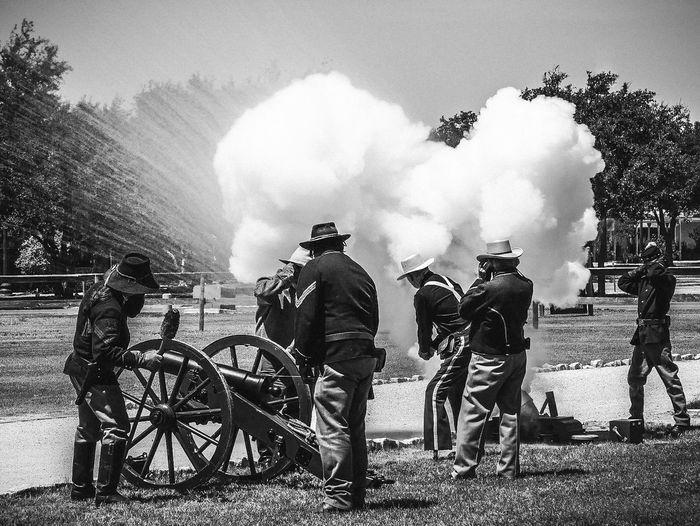 Full Length On Men Standing By Smoke At War