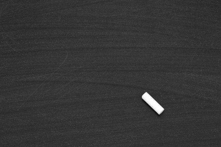High Angle View Of Chalk On Slate