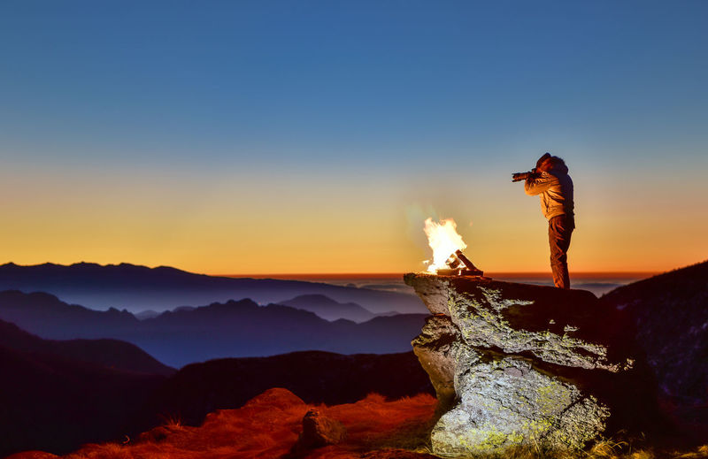 Scenic View Of Man Photographing Landscape
