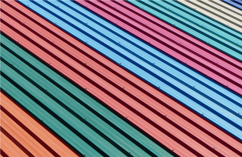 Full frame shot of multi colored metal sheet of roof pattern