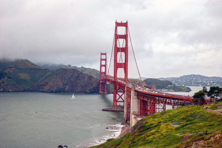 Bridge Transportation Built Structure Architecture Water Bridge - Man Made Structure Suspension Bridge Sky Mountain Engineering Bay Connection Cloud - Sky Bay Of Water Travel Destinations Nature Travel Day Red Outdoors Golden Gate Bridge