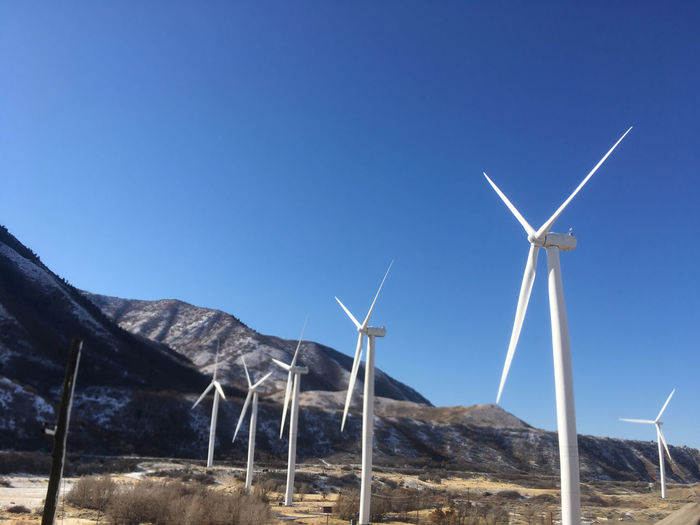 Environmentally friendly wind turbines with massive blades turn in the wind producing green, renewable energy. Blue skies. Mountains and grass. Spanish Fork Canyon, Spanish Fork, Utah, United States. Alternative Energy Beauty In Nature Clean Energy Clean Environment Clear Sky Day Enviormental Issues Fuel And Power Generation Green Energy Green Environment Industrial Windmill Nature No People Outdoors Sky Spanish Fork Canyon Spanish Fork Utah Spanish Fork,ut Wind Energy Wind Power Wind Turbine Wind Turbine Wind Turbines Wind Turbines On A Field Windmill