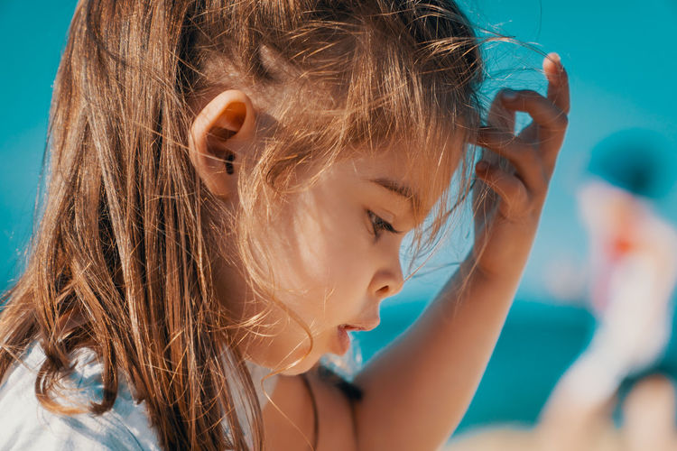Summer Child Girl Kid Sea Beach Water Sky Headshot Portrait Childhood Close-up Girls One Person Women Focus On Foreground Brown Hair Females Side View Day Leisure Activity Offspring Hair Human Body Part Body Part Innocence Hairstyle Swimming Pool Human Face Outdoors Contemplation