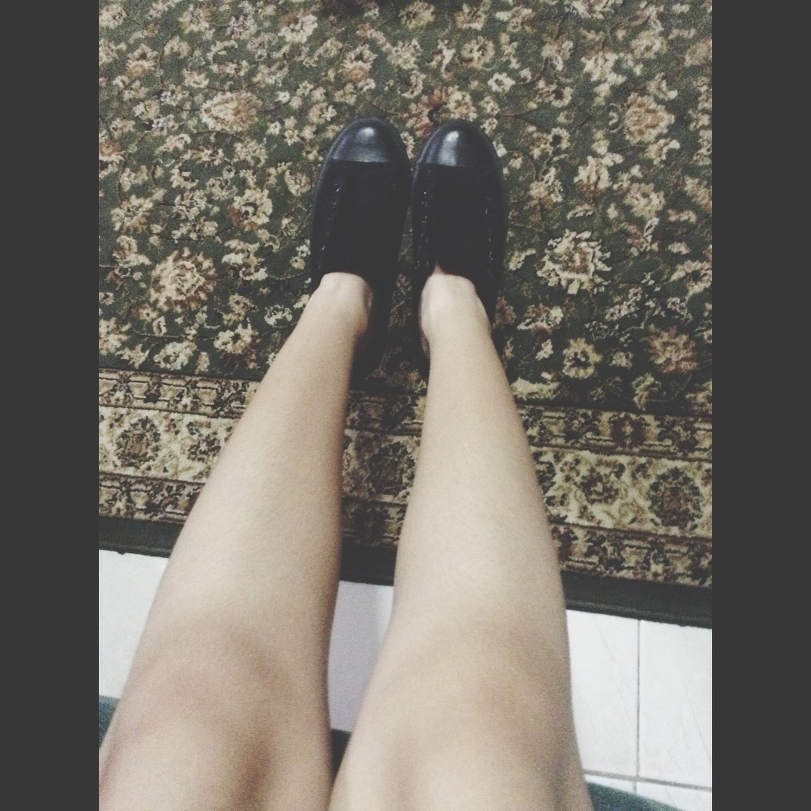person, low section, personal perspective, lifestyles, indoors, human foot, standing, shoe, part of, leisure activity, barefoot, femininity, sensuality, high angle view, fashion, legs crossed at ankle
